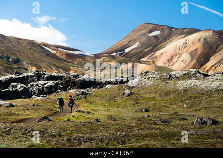Hikers, Laugahraun lava field and rhyolite mountains on the Laugavegur hiking trail, Landmannalaugar Hrafntinnusker - Stock Photo
