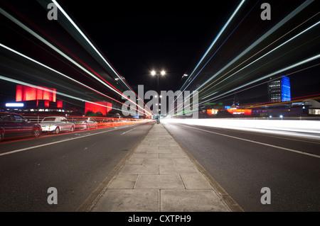 Night Time Traffic on Waterloo Bridge, London - Stock Photo