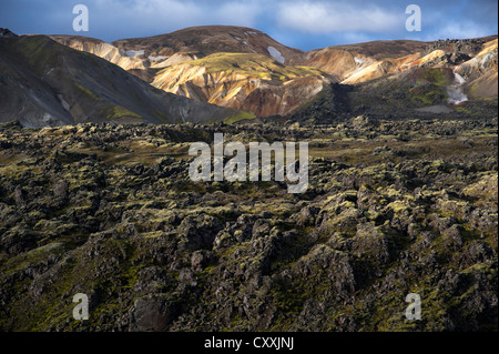 Rhyolite mountains and Laugahraun lava field, Landmannalaugar, Fjallabak Nature Reserve, Highlands of Iceland, Iceland, - Stock Photo