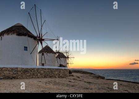 Sunset at the famous windmills of Mykonos, Greece - Stock Photo