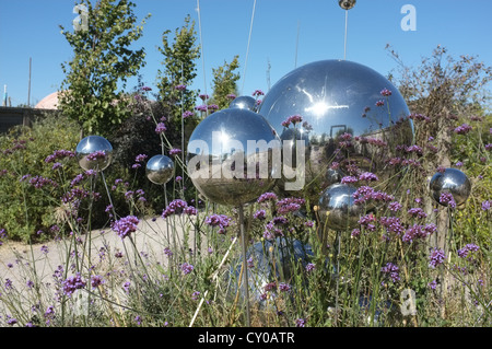 A modern garden with steel spheres at Butterfly World, St Albans, Hertfordshire - Stock Photo