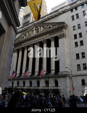 View neo-classical New York Stock Exchange, people walking, Broad Street from 23 Wall Street, Financial District, - Stock Photo