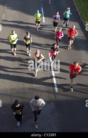 Marathon runners aerial race athletes running on road Palma de Mallorca Spain 2012 - Stock Photo