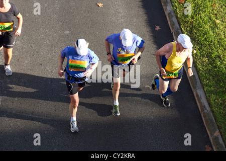 Marathon runners aerial men race athletes running on road Palma de Mallorca Spain 2012 - Stock Photo