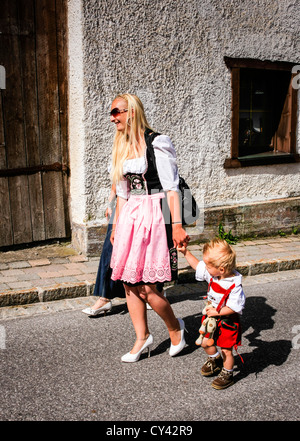 Mother and child in traditional Austrian sunday clothes - Stock Photo
