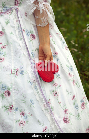 detail view of a woman holding a heart - Stock Photo