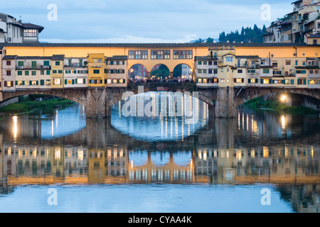 Evening view of historic ponte Vecchio bridge over Arno River in Florence Italy - Stock Photo