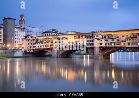Evening view of historic ponte Vecchio bridge over Arno River in Florence Italy - Stock Photo