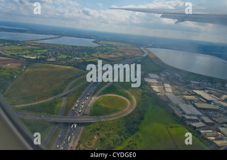 An aerial view of the M25 motorway around London near to Heathrow airport, seen from the window of a commercial - Stock Photo