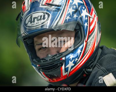 Motorbike rider wearing Arai helmet - Stock Photo