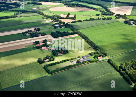 The Netherlands, Stadskanaal. Farms and farmland. Aerial. - Stock Photo