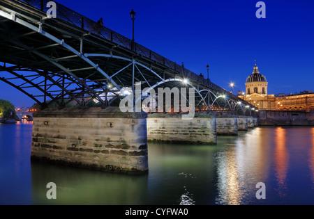 The Pont des Arts or Passerelle des Arts, bridge across river Seine and Institut de France in Paris, France. - Stock Photo