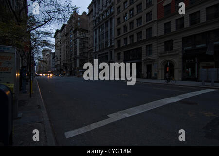 New York USA. November 1st 2012. Only distant vehicle headlights illuminate 5th Avenue looking North in the Chelsea - Stock Photo