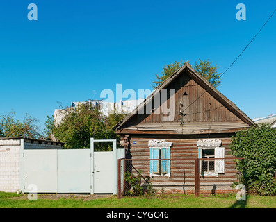 Classical old wooden house - izba on the old street Gomel city. - Stock Photo