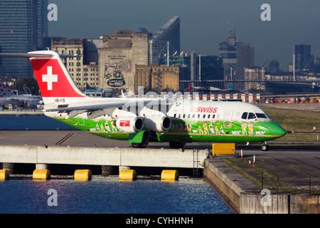 Regional airliner Swiss International Air Lines BAE Systems Avro 146-RJ100 at London City Airport, England, UK - Stock Photo