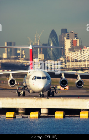 Regional airliner at London City Airport, England, UK - Stock Photo