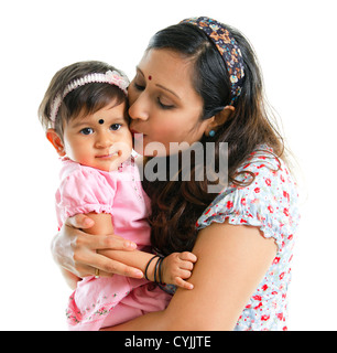Asian Indian mother kissing her baby girl, isolated on white background - Stock Photo