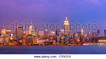 Panoramic skyline view of New York City, Manhattan, featuring the Empire State Building as seen from across the - Stock Photo