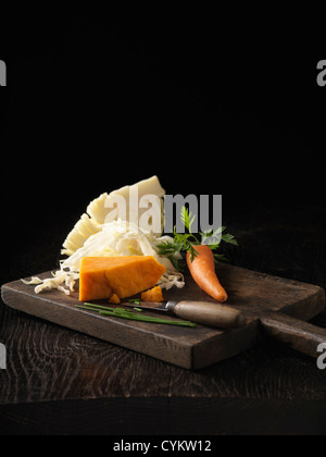 Onion, carrot and cabbage on board - Stock Photo