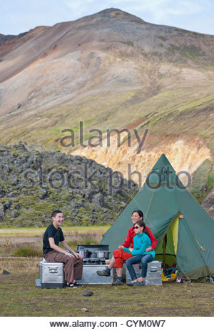 Family relaxing at campsite - Stockfoto