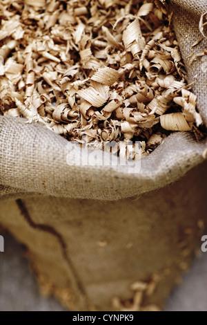 burlap sack of shavings, close up - Stock Photo