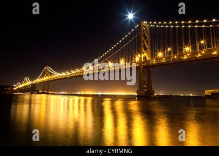San Francisco Bay bridge in the night - Stock Photo