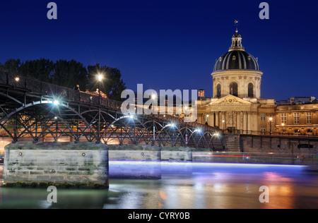 The Institut de France and the Pont des Arts in Paris, France. - Stock Photo