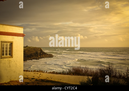 Sunset on a beach in Portugal - Stock Photo