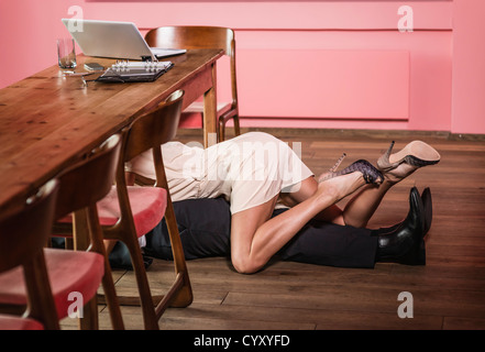 Germany, Stuttgart, Business couple in romance at apartment - Stock Photo