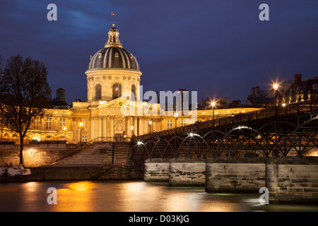 Twilight over Academie Francaise and River Seine, Paris France - Stock Photo