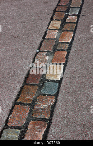 Cobblestones' line that marks, along 160 km., the place where was the Berlin Wall. Germany. - Stockfoto
