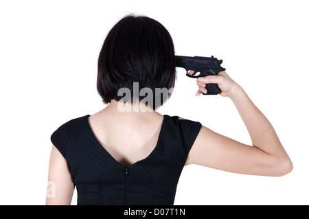Woman with pistol pointing on her head, rear view isolated on white. - Stockfoto