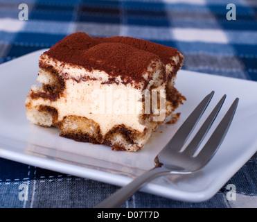Close up portion of tiramisu on a plate - Stock Photo