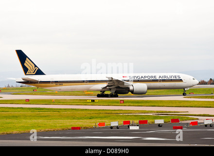 Singapore Airlines Boeing 777-312ER Airliner 9V-SWS Taxiing for Departure at Manchester Airport England United Kingdom - Stock Photo