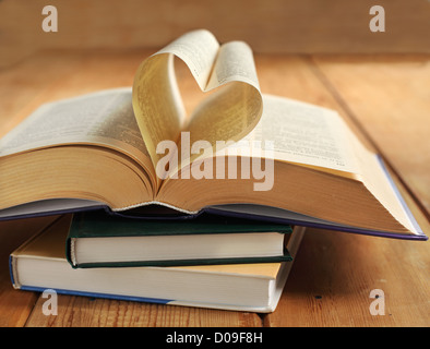 Opened book. Pages of the book folded into a heart shape - Stock Photo