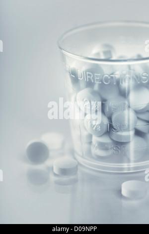 yellow pills close-up, selective focus - Stock Photo