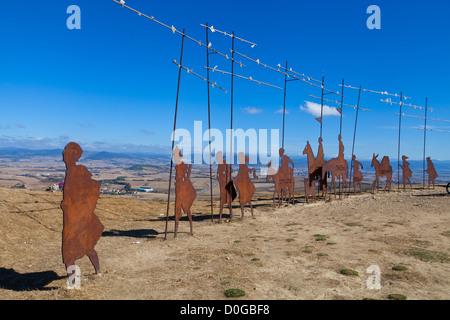 Cast Iron, Silhouette, Pilgrim Statues on the ridge, Alto de Perdon, The French Route, Camino to Santiago de Compostela, - Stock Photo