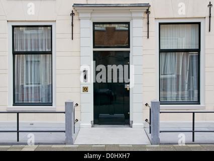 Front door of a Dutch town house in Groningen - Stock Photo