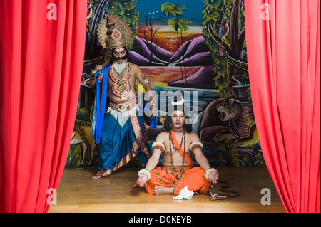 Two stage artists dressed-up as Rama and Ravana the Hindu mythological characters - Stock Photo