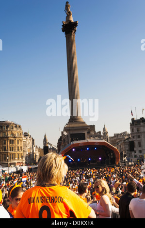 People in front of Nelson's Column in Trafalgar Square as part of a celebration of Dutch culture during the Holland - Stock Photo