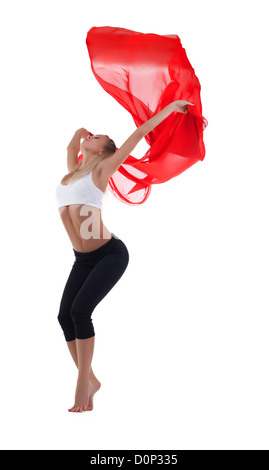 Young blond woman dance with red flying fabric - Stock Photo