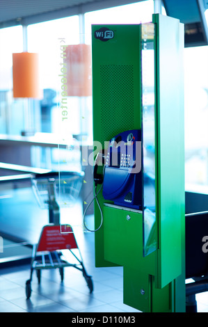 Telephone box in an International Airport - Stock Photo