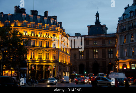 Grand Hotel du louvre at Place du Palais-Royal at night, Paris. Ile-de-France, Paris, France. - Stock Photo