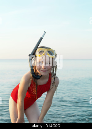 Girl wearing snorkel and mask in water - Stock Photo