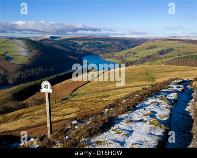 Ladybower reservoir from a frost covered Derwent Edge in the Peak District - Stock Photo