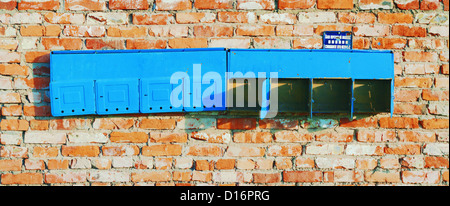 Background - aged brick construction wall with old post boxes. - Stock Photo