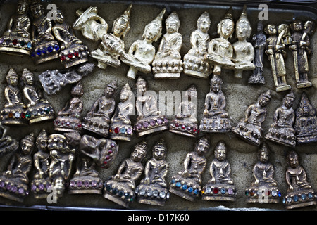 Religious relics sold by street vendor - Stock Photo