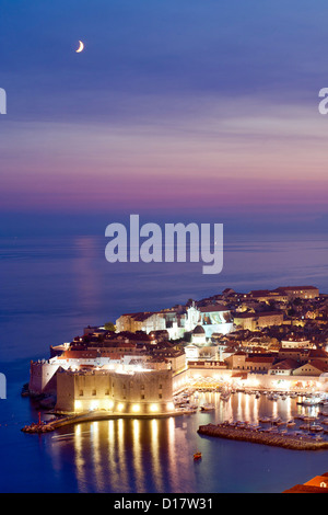 Dusk view of the old harbour port and old town in the city of Dubrovnik on the Adriatic coast of Croatia. - Stock Photo