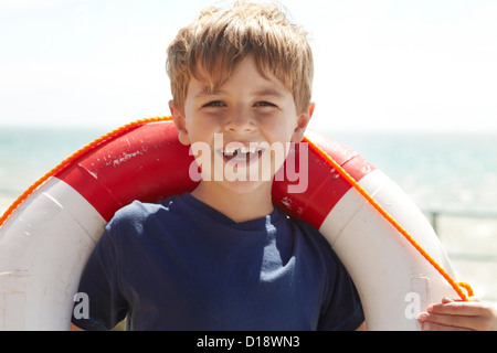 Boy with a life ring - Stock Photo