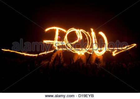 I love you written in night sky with sparklers - Stock Photo